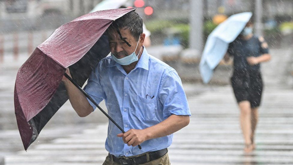 Typhoon In-Fa sweeps into China after flooding chaos