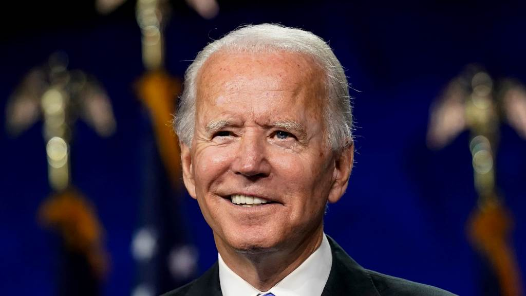 Biden takes office as WHO, aides hype up climate change accord